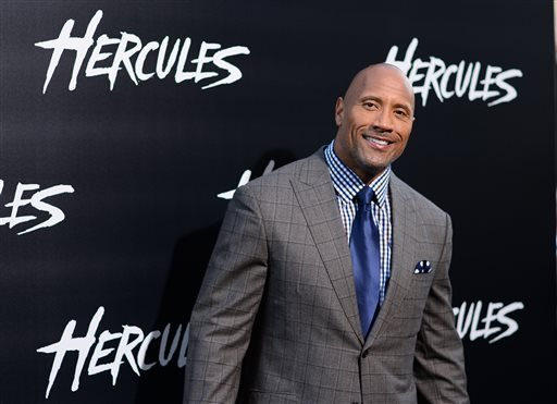 """Dwayne Johnson arrives at the premiere of """"Hercules"""" at TCL Chinese Theatre on Wednesday, July 23, 2014, in Los Angeles. (Photo by Jordan Strauss/Invision/AP)"""