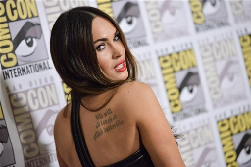 "Megan Fox attends the ""Teenage Mutant Ninja Turtles"" press line on Day 1 of Comic-Con International on Thursday, July 24, 2014, in San Diego. (Photo by Richard Shotwell/Invision/AP)"