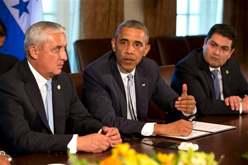 Guatemala's President Otto Perez Molina, left, and Honduran President Juan Hernandez, right, listen as U.S. President Barack Obama speaks to the media, after they met to discuss Central American immigration and the border crisis. (AP)