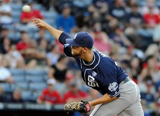 San Diego Padres starting pitcher Jesse Hahn delivers to the Atlanta Braves during the first inning of a baseball game Friday, July 25, 2014, in Atlanta. (AP Photo/David Tulis)