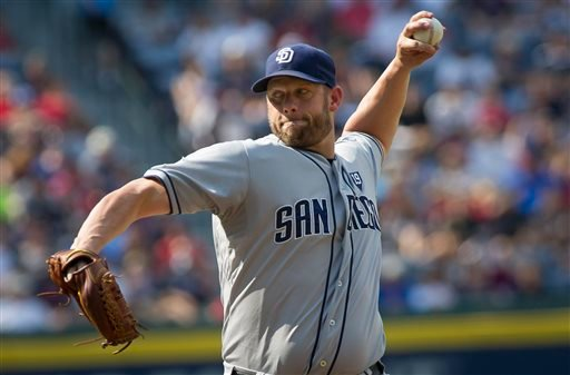 San Diego Padres' Eric Stults pitches against the Atlanta Braves during the first inning of a baseball game, Sunday, July 27, 2014, in Atlanta. (AP Photo/John Amis)