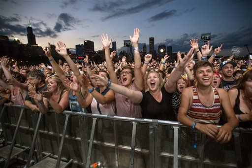 This Aug. 3, 2013 file photo shows fans reacting while Mumford & Sons performs at the Lollapalooza Festival in Chicago.