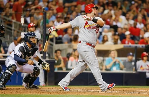 St. Louis Cardinals' Matt Adams watches his deep drive against the San Diego Padres with two runners on base in the third inning of a baseball game Tuesday, July 29, 2014, in San Diego. The ball came up just short for a long out.