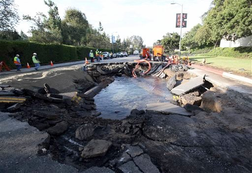 The site of a water main break is shown near UCLA Wednesday July 30, 2014, in Los Angeles. (AP)