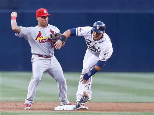 St. Louis Cardinals second baseman Kolten Wong is unable to get off a decent relay after getting a force out on San Diego Padres' Everth Cabrera at second base in the first inning of a baseball game Wednesday, July 30, 2014, in San Diego.