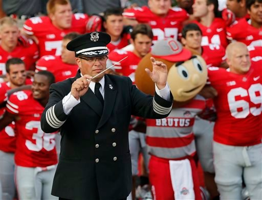 """In this Sept. 7, 2013 photo, Ohio State University marching band director Jon Waters leads the band in """"Carmen Ohio"""" following a NCAA football game against San Diego State at Ohio Stadium in Columbus, Ohio. (AP)"""