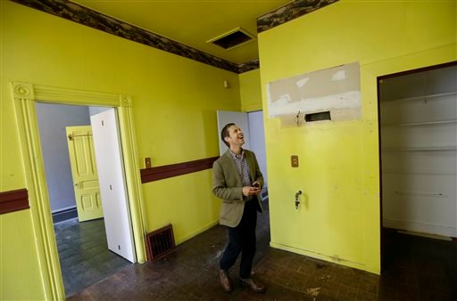 George Limperis, a realtor with Paragon Real Estate Group, smiles while walking through the kitchen of a property in the Noe Valley neighborhood in San Francisco, Wednesday, July 30, 2014.