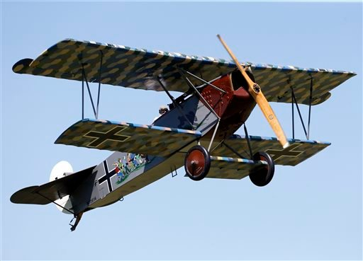 Ken Cassens pilots a World War 1-era Fokker D-VII reproduction bi-plane during an air show at the Old Rhinebeck Aerodrome on Sunday, July 6, 2014, in Rhinebeck, N.Y. (AP Photo/Mike Groll)