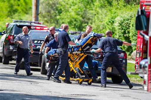 In this May 31, 2014 file photo rescue workers take a 12-year-old stabbing victim to the ambulance in Waukesha, Wis.