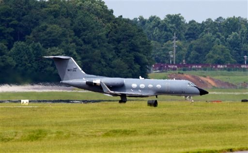 A plane taxies after arriving at Dobbins Air Reserve Base in Marietta., Ga., Saturday, Aug. 2, 2014.