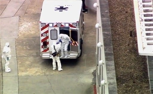 An ambulance arrives with Ebola victim Dr. Kent Brantly, right, to Emory University Hospital, Saturday, Aug. 2, 2014, in Atlanta.