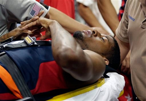 Indiana Pacers' Paul George is taken off the court after he was injured during the USA Basketball Showcase game Friday, Aug. 1, 2014, in Las Vegas. (AP Photo/John Locher)