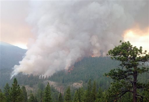 This Monday, July 28, 2014 photo released Thursday, July 31, 2014 by the U.S. Forest Service, shows flames and smoke in the Sierra National Forest, Calif.