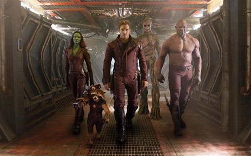 "This image released by Disney - Marvel shows, from left, Zoe Saldana, the character Rocket Racoon, voiced by Bradley Cooper, Chris Pratt, the character Groot, voiced by Vin Diesel and Dave Bautista in a scene from ""Guardians of the Galaxy."""