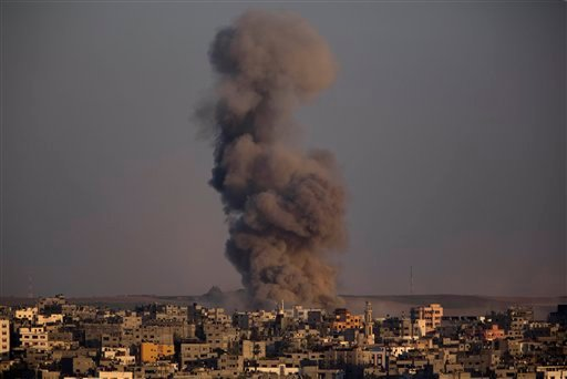 Smoke rises after an Israeli airstrike in Gaza City, Sunday, Aug. 3, 2014. (AP Photo/Dusan Vranic)