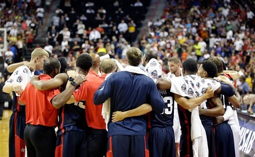 Team USA players and coaches huddle after Indiana Pacers' Paul George was injured during the USA Basketball Showcase game Friday, Aug. 1, 2014, in Las Vegas. (AP Photo/John Locher)