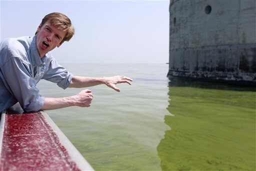 Collin O'Mara, president and CEO of the National Wildlife Federation, gestures as he talks about algae near the City of Toledo water intake crib, Sunday, Aug. 3, 2014, in Lake Erie, about 2.5 miles off the shore of Curtice, Ohio.