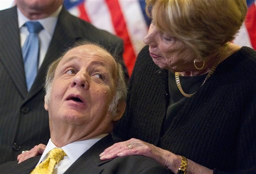 This March 30, 2011 file photo shows former White House press secretary James Brady, left, who was left paralyzed in the Reagan assassination attempt, looking at his wife Sarah Brady...