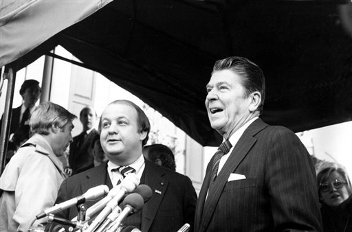 This Jan. 6, 1981 file photo shows President-elect Ronald Reagan introducing James Brady as his press secretary in Washington.