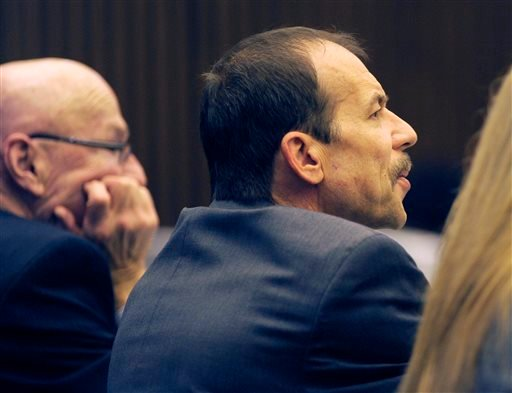 Theodore Wafer, right, listens during closing arguments of his trial Wednesday, Aug. 6, 2014 in Detroit. (AP)