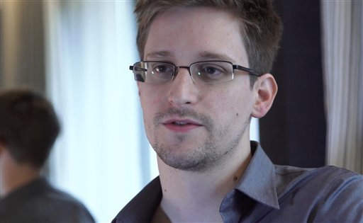 June 9, 2013 file photo provided by The Guardian Newspaper in London shows Edward Snowden, who worked as a contract employee at the National Security Agency, in Hong Kong. (AP Photo/The Guardian, Glenn Greenwald and Laura Poitras, File)