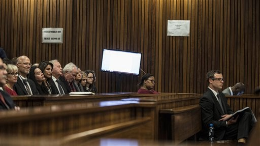 Oscar Pistorius, right, listens in court as state prosecutor Gerrie Nel sums up evidence in court at his murder trial in Pretoria, South Africa Aug. 7 2014. (AP Photo/Mujahid Safodien, Pool)