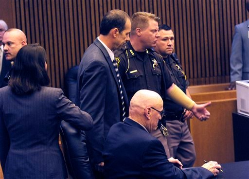 Theodore Wafer, left, is lead out of the courtroom after being found guilty of of second-degree murder and manslaughter Thursday, Aug. 7, 2014 in Detroit. (AP)