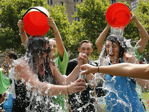 Two women get doused during the ice bucket challenge at Boston's Copley Square, Thursday, Aug. 7, 2014 to raise funds and awareness for ALS. (AP)