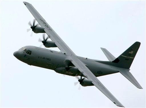 This June 20, 2007, file photo shows a C-130-J transport aircraft over Little Rock Air Force Base in Jacksonville, Ark.