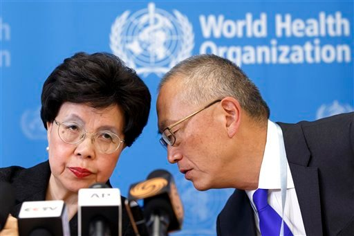 Director General of the World Health Organization, WHO, China's Margaret Chan and Assistant Director General for Health Security Keiji Fukuda of the US, right, share a word during a press conference after an emergency meeting, Aug. 8, 2014.