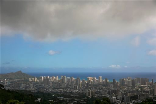 Clouds hang over Honolulu, seen from the top of Tanalus Drive on Thursday, Aug. 7, 2014. With Iselle, Hawaii is expected to take its first direct hurricane hit in 22 years. Tracking close behind it is Hurricane Julio. (AP Photo/Marco Garcia)