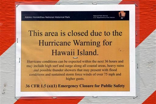 A hurricane warning sign is shown posted on the beach in Kailua, Hawaii, Thursday, Aug. 7, 2014, as the area prepares for Hurricane Iselle.