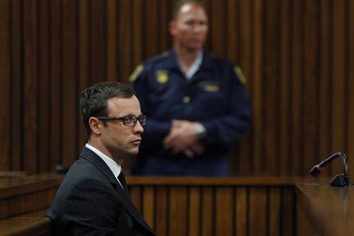 Oscar Pistorius sits in court during his trial, in Pretoria, South Africa, Friday, Aug. 8, 2014.