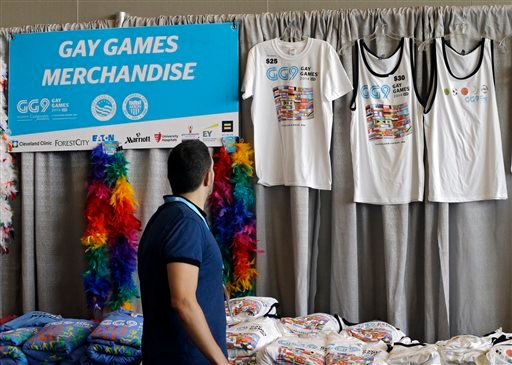 A man looks over Gay Games t-shirts for sale in the downtown convention center in Cleveland Thursday, Aug. 7, 2014.