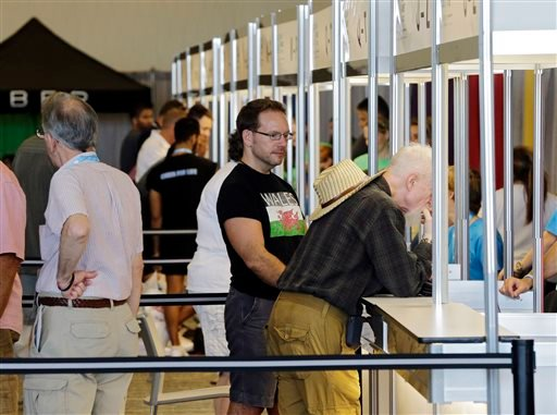 Participants register for the 9th International Gay Games at the downtown convention center in Cleveland Thursday, Aug. 7, 2014.