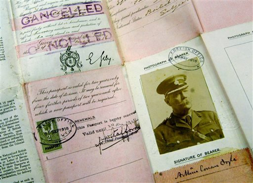 This May 13, 2004 file photo shows Sir Arthur Conan Doyle's passport dating from World War I on display at Christie's auction house in London.