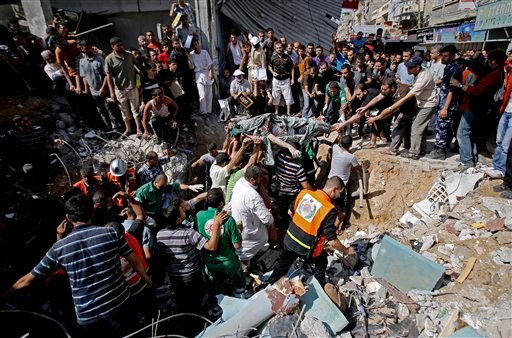 Palestinians remove the body from under the rubble of al-Qassam mosque in Nuseirat refugee camp, central Gaza Strip, after it was hit by an Israeli airstrike, Saturday, Aug. 9, 2014. (AP Photo/Hatem Moussa)