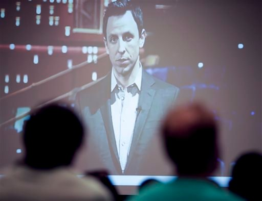 """Students watch a public service announcement called, """"1 is 2 Many,"""" featuring actor Seth Meyers among others, during an orientation meeting Friday, Aug. 1, 2014, in San Diego."""