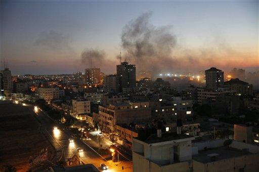 Smoke from fires caused by Israeli strikes rises over Gaza City, Sunday, Aug. 10, 2014. (AP Photo/Lefteris Pitarakis)