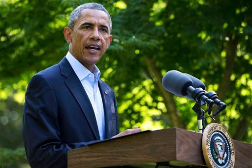 President Barack Obama speaks about developments in Iraq, Monday, Aug. 11, 2014, from Chilmark, Mass., during his family vacation on the island of Martha's Vineyard. (AP Photo/Jacquelyn Martin)
