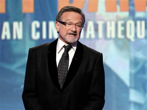 This March 27, 2010 file photo shows actor Robin Williams speaking at The 24th American Cinematheque Awards honoring Matt Damon in Beverly Hills, Calif.