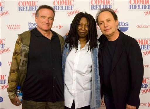 "This Nov. 18, 2006 file photo shows comedians Robin Williams, from left, Whoopi Goldberg and Billy Crystal posing after hoasting ""Comic Relief"" at Caesars Palace Hotel and Casino in Las Vegas, Nev."
