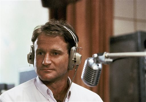"""This 1987 file photo released by Touchstone Pictures shows actor Robin Williams in character as disc-jockey Adrian Cronauer in director Barry Levinsons comedy drama, """"Good Morning Vietnam."""""""