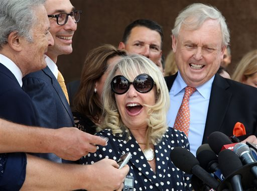 In this July 28, 2014, file photo, with her attorney Pierce O'Donnell, right, Shelly Sterling, center, talks to reporters after a judge ruled in her favor and against her estranged husband, Los Angeles Clippers owner Donald Sterling.