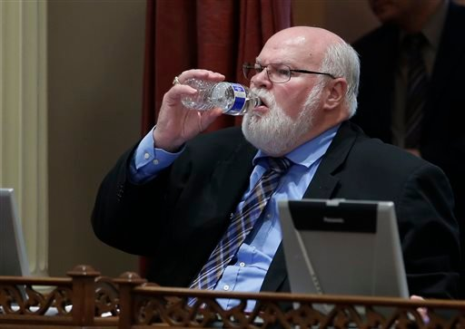 State Sen. Jim Beall, D-San Jose, drinks from a bottle of water during the Senate session at the Capitol in Sacramento, Calif. on Wednesday, Aug. 13, 2014. (AP Photo/Rich Pedroncelli)