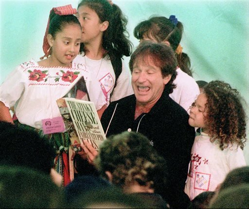 "In this April 21, 1996 file photo, Robin Williams reads ""Stinky Cheese"" to a group of children during a special children's program at the new main library in San Francisco."