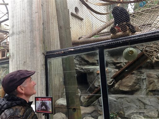 "In this photo taken June 6, 2014 provided by the San Francisco Zoological Society, Robin Williams visits his namesake Howler monkey named ""Robin"" at the San Francisco Zoo in San Francisco."