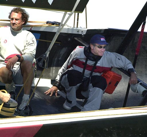 In this Sept. 20, 2003 file photo, actor Robin Williams, right, rides onboard Alinghi as the boat races against Oracle BMW Racing during the final day the Moet Cup in San Francisco.