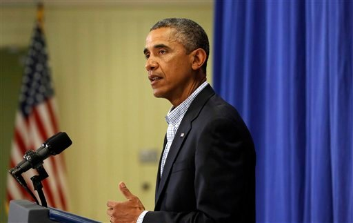 President Barack Obama speaks to reporters, Thursday, Aug. 14, 2014, in Edgartown, Mass. about developments in Iraq and the police shooting of 18-year-old Michael Brown, in Ferguson, Mo. Obama is vacationing on the island for about two weeks. (AP Photo)