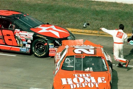 FILE - In this Oct. 3, 1999, file photo, Tony Stewart throws a piece of equipment in the direction of the car of Kenny Irwin (28) after leaving his wrecked car, right, in turn one of the Martinsville Speedway during the NAPA AutoCare 500. (AP)